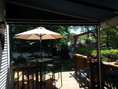 Sunny deck looking into back yard.  Deck also partially covered with awning.