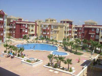 Photo for Luxury high spec 2 bed apartment overlooking pool with A/C