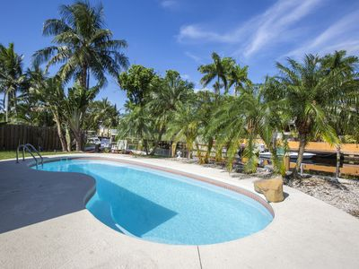 Photo for Tropical Oasis on the Water-HEATED POOL with dock