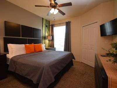 Photo for 1-103 Poolside Bamboo Themed Condo just ten minutes from Disney with heated pool
