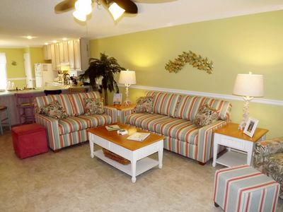 Third floor living area with NEW love seat and queen sleeper sofa
