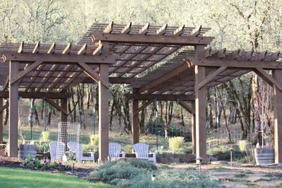 pergola with large paver patio and firepit
