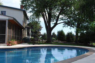 Beautiful PRIVATE pool next to huge screened porch + 4 bedrooms + 3 FULL baths