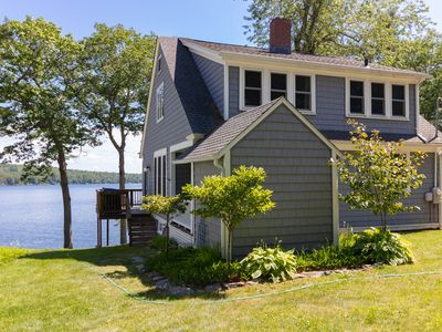 Photo for Rustic lakefront home w/ private dock, wood fireplace & modern conveniences