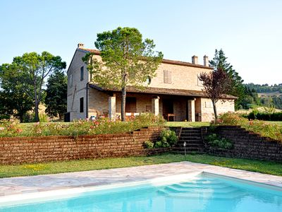 Photo for Villa with swimming pool, large fenced garden and landscape of the Marche hills