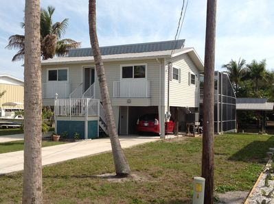 Convenient off street parking in two carports, lanai, and boat dock.