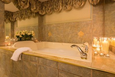 Royal Jacuzzi Suite has a double wide Jacuzzi tub and two-headed walk-in shower.