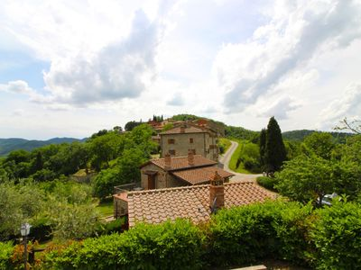 Photo for Old stone hamlet located on a panoramic hill close to the city of Arezzo. Beautiful infinity pool, 2