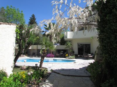Photo for sunny cottage in mature garden, pool and private parking