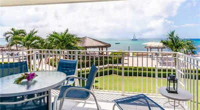 Photo for Bright and Cheery Oceanfront Condo with Panoramic Views of the Caribbean Sea