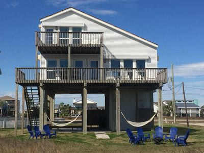 View from the beach - large grassy area surrounds the home