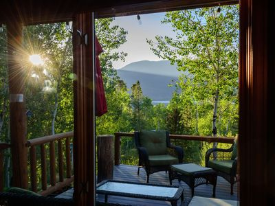 Photo for Beautiful setting, large deck with  lake and mountain views, private creek