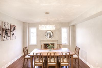 Dining table in front of the fireplace