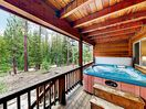 Hot Tub - Take a relaxing soak in your private hot tub on the covered deck.