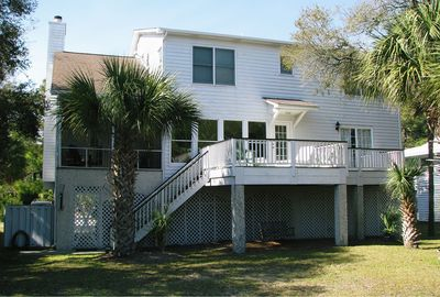 back view of the house and deck and swing