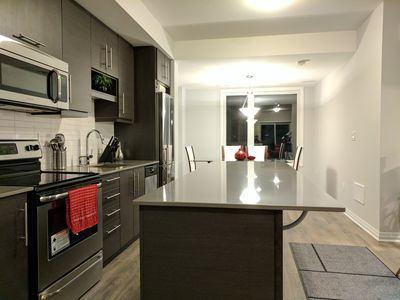 Photo for 6 Bedroom New Entire House in the middle of Toronto CIty, 10 mins to Airport