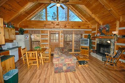 Welcoming Living Room with Log Fireplace