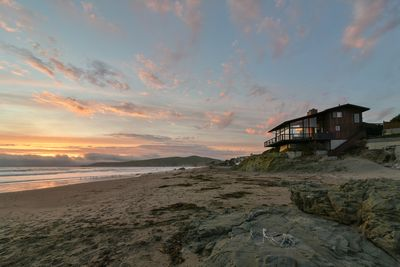 You'll watch amazing sunsets from the deck, view room, or strolling on the beach