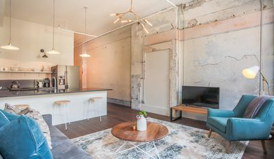 Photo for Stay with Lucky Savannah: Modern suite with exposed brick walls & wood floors