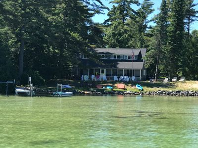 View of the Gray House at Penwood including the dock, the kayaks and the canoe.