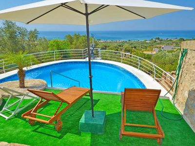 Photo for Villa with garden, pool and sea view