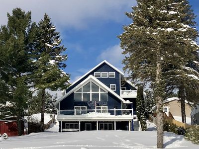 Photo for Close to ski/ snowmobile trails/ hot tub/ 3 fireplaces/ ice fishing.