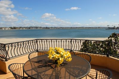 Private patio runs length of building with floor to ceiling beach front doors