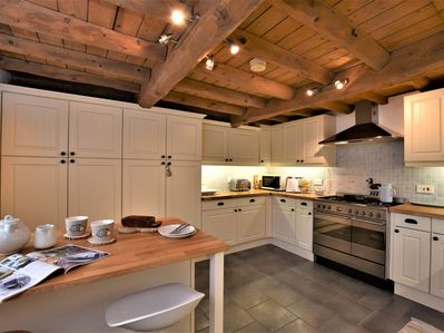 Prepare a meal in the warm and inviting kitchen
