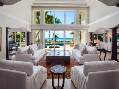 Photo for Coconut Walk: Luxurious Seven Mile Beach Mansion with a Secluded Barefoot Beach and Pool