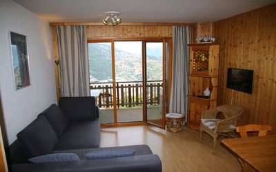 Photo for 2* Studio for 2-4 people located at about 700m from the gondola in a calm and sunny area.  Living ro