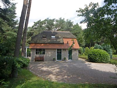Photo for Holiday home with a wonderful terrace and French doors on the edge of the forest