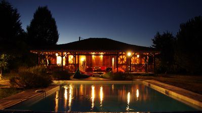 Photo for Léon, exotic wooden house on large plot, swimming pool