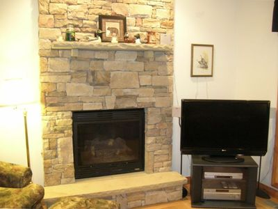 Family Room Gas Fireplace with Stone Facade