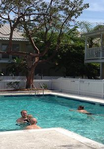 Folks enjoying the gated pool only a couple hundred ft from Tiki Beach townhouse