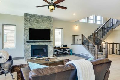 Soaring Staircase Frame Great Room