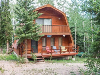 Photo for Charming log cabin with beautiful views of the area! Enjoy the fresh mountain air while you BBQ on t
