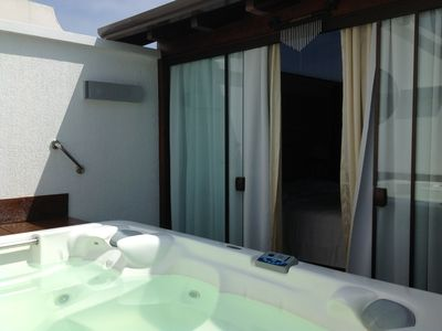 Photo for Luxurious penthouse on the seafront, with sea view, jacuzzi, 2 grills