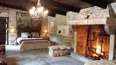 Photo for Authentic lodge in the middle of the woods fireplace and hammam