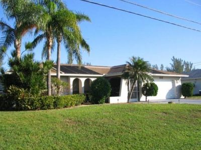 Photo for Palm Tree - Gulf Access Home with Solar Heated Pool