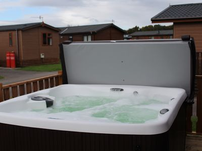 Photo for 69 Gressingham - Wooden top Lodge with Hottub