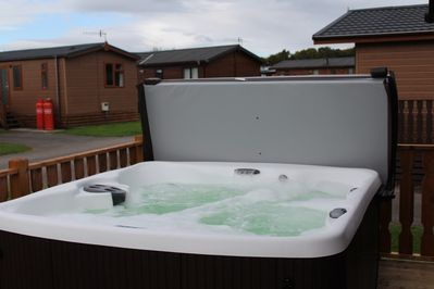 Amazingly relaxing 2016 Hot tub on your Decking. Relax after a day of exploring.