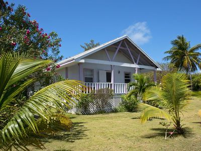 Photo for ORCHID COTTAGE-COLOURFUL BAHAMIAN COTTAGE STEPS FROM ATLANTIC BEACH