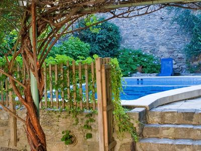 Photo for Lovely town house with gorgeous peaceful secluded garden with pool