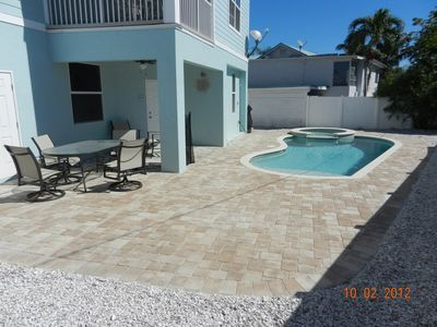 Photo for New 2012 6 Bedroom,5 Bath pool home w/(2)110' tv's 1 at pool & 1 in livingroom