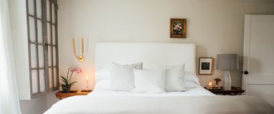 Cozy kind size bed is super comfy with luxury linens.