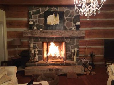 The huge fieldstone fireplace in the living room