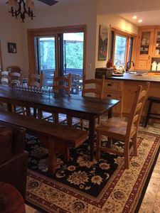 Dining table seats 18 adults, depending on size