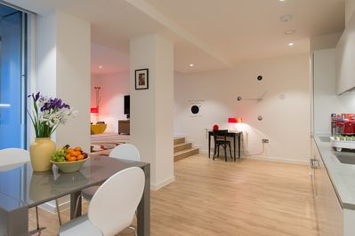 Open plan kitchen and dining area. AMP LONDON