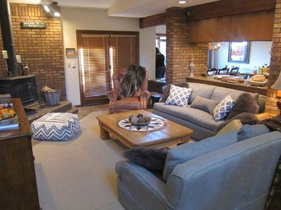 The spacious living room is open to the dining and kitchen, also access to deck.