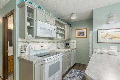 Kitchen with full size appliances, garbage disposal, microwave and ice maker